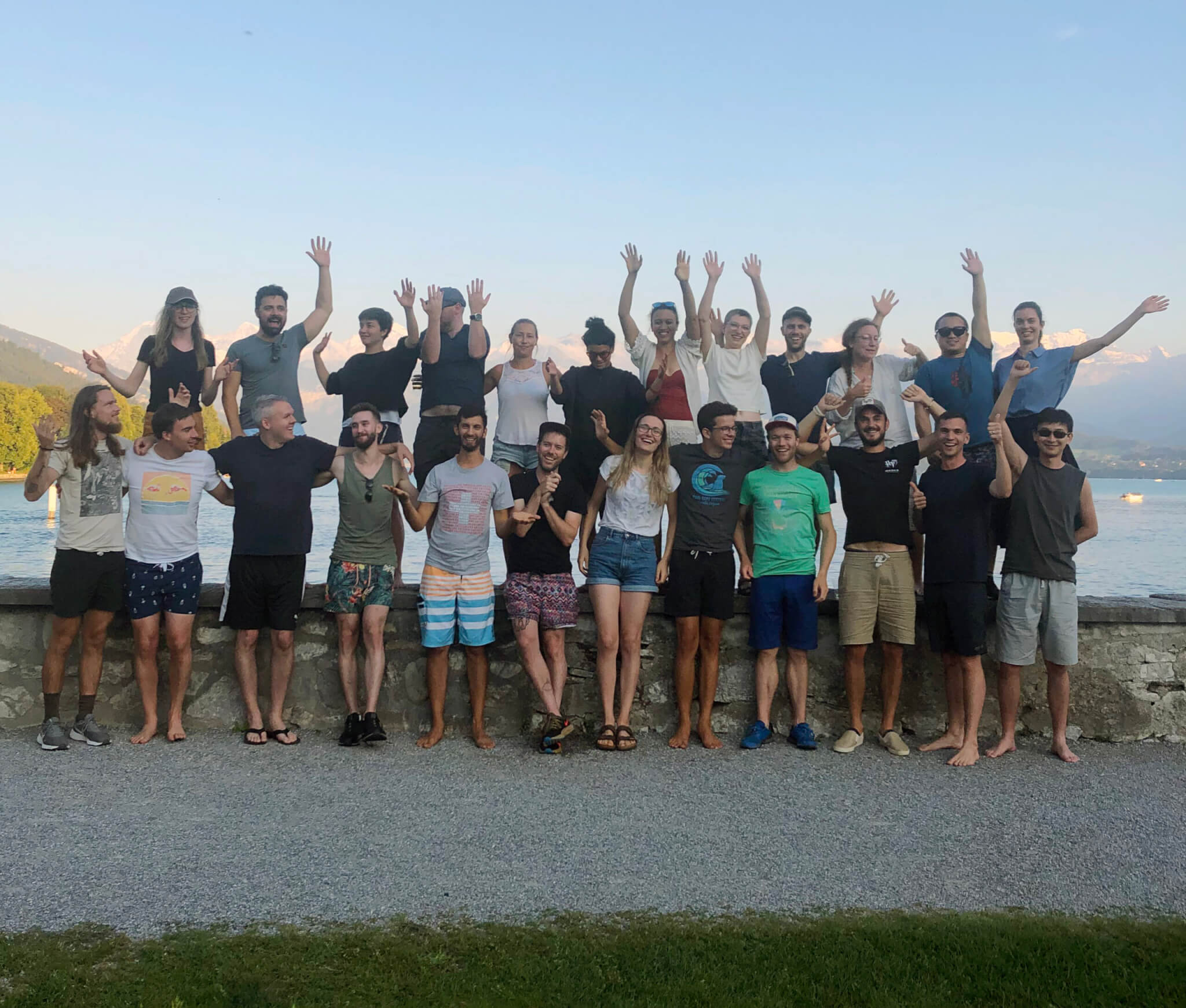 The Crowther Lab members posing for a group picture in front of a lake